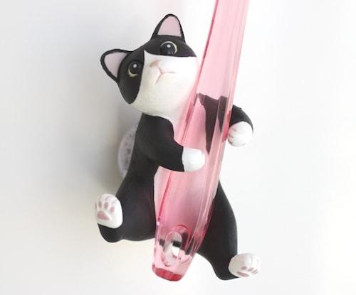 猫が歯ブラシをキャッチしてくれる猫グッズ