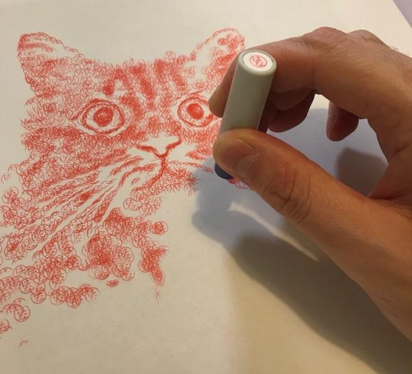 ハンコで猫を描いている様子 by スーパーハンコアート作家 安東和之