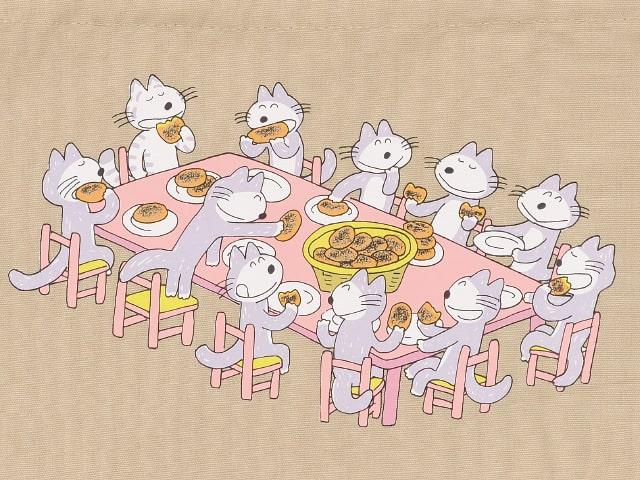 絵本「11ぴきのねことあほうどり」のワンシーンで、ねこたちが皆で楽しくコロッケを食べているイラスト