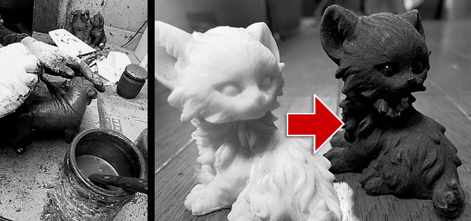 竹炭塗料によって猫の型を塗装する作業イメージ