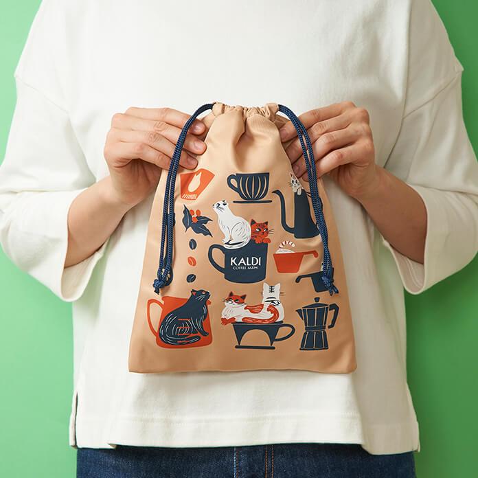 「ニャンコーヒーセット」の巾着袋、表のデザイン by カルディコーヒーファーム(KALDI COFFEE FARM)