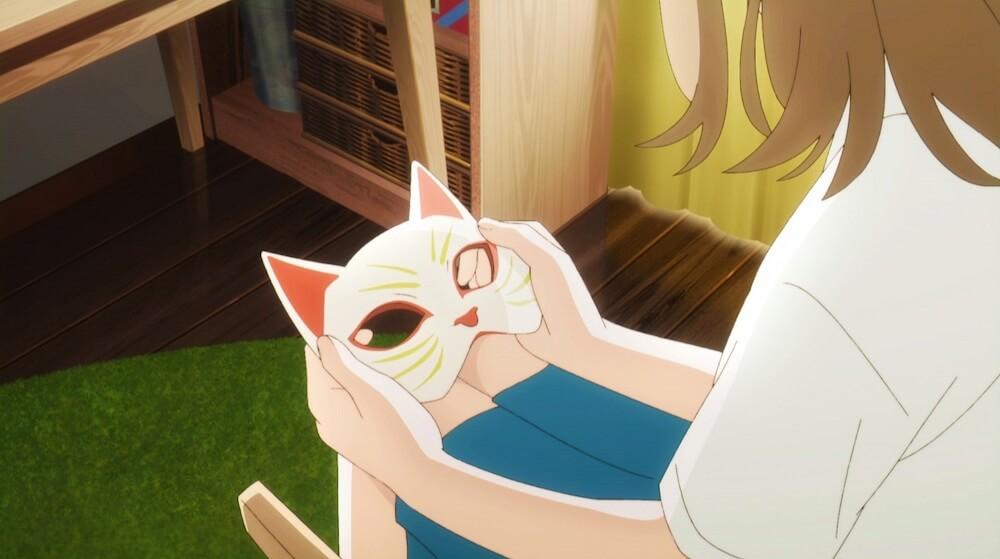 猫のお目を手にする主人公のムゲこと笹木美代 by 映画「泣きたい私は猫をかぶる」のワンシーン