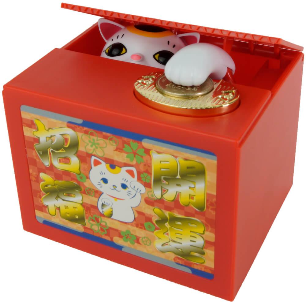 猫がお金を隠す貯金箱いたずらBANKシリーズの最新作「開運!招き猫BANK」の製品イメージ
