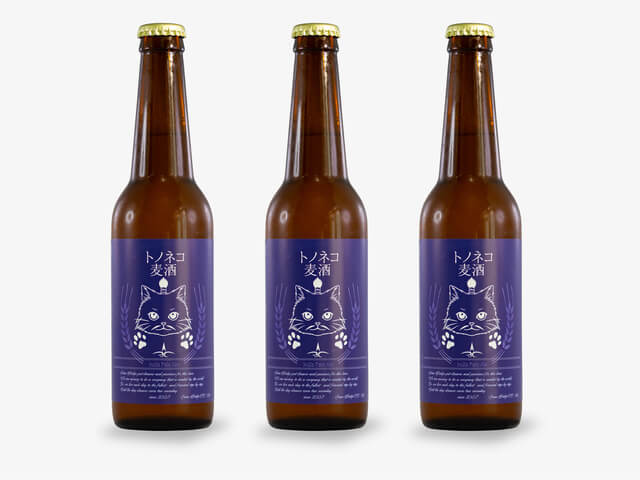 猫のイラストがデザインされたクラフトビール「トノネコビール」の商品イメージ