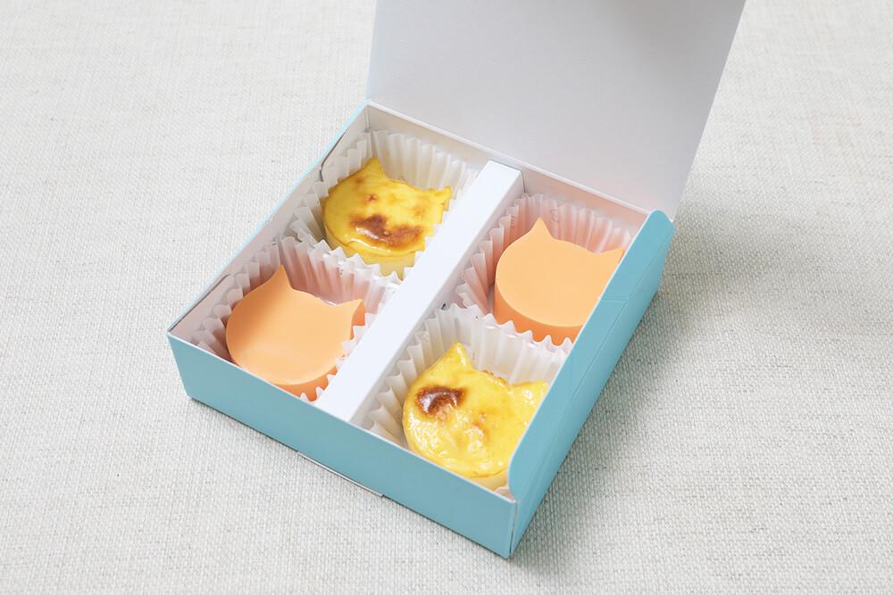 オレンジ味のバスク風チーズケーキ「にゃんチーみかん」製品パッケージ by ねこねこチーズケーキ