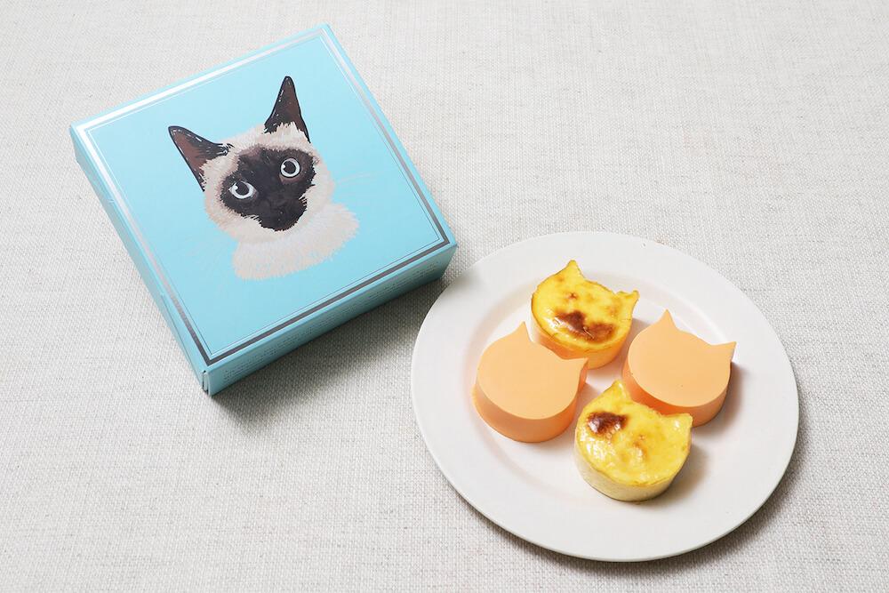 オレンジ味のバスク風チーズケーキ「にゃんチーみかん」パッケージを開封したイメージ by ねこねこチーズケーキ