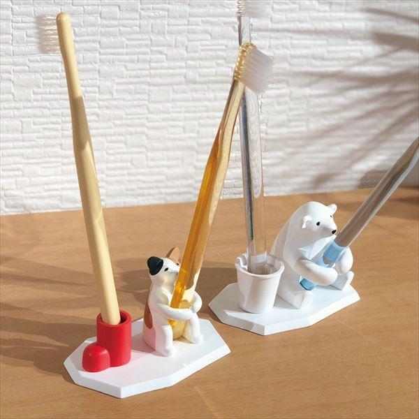歯ブラシホルダー「釣り猫」と「釣り熊」に歯ブラシを立て掛けたイメージ